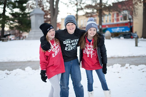 Magical Things to Do in Downtown Baraboo kids in snow